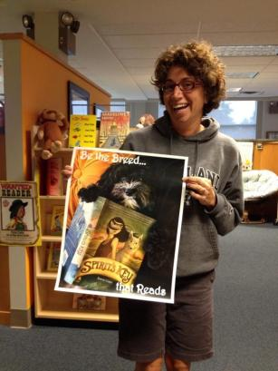 Stacey Rattner, a K-5 Librarian, with her Spirit's Key literacy poster