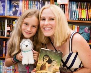 Alice is reading SPIRIT'S KEY with her mother. She brought her own stuffed Sky to the party.